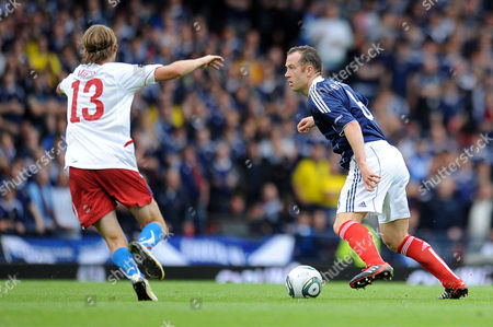 Football - Euro 2012 Qualifier - Scotland vs Czech Republic Charlie Adam (Scotland) looks for the space to play the ball at Hampden Park