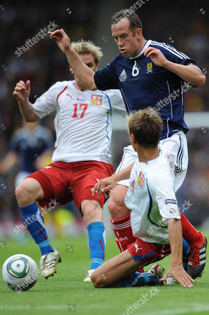 Stock Photo of Football - Euro 2012 Qualifier - Scotland vs Czech Republic Charlie Adam (Scotland) has his run cut short when Jan Rajnoch (Czech Republic) brings him down at Hampden Park
