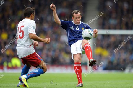 Football - Euro 2012 Qualifier - Scotland vs Czech Republic Charlie Adam (Scotland) clears as Milan Baros (Czech Republic) closes in at Hampden Park