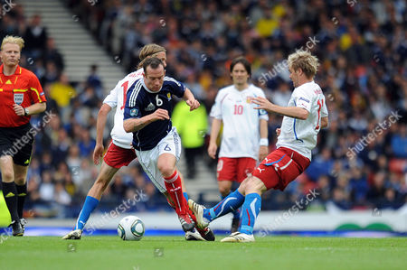Football - Euro 2012 Qualifier - Scotland vs Czech Republic Charlie Adam (Scotland) is fouled by Tomas Hubschman (Czech Republic) at Hampden Park