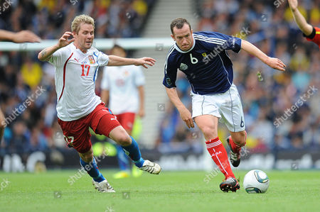 Football - Euro 2012 Qualifier - Scotland vs Czech Republic Charlie Adam (Scotland) pushes forward as Tomas Hubschman (Czech Republic) shadows him at Hampden Park