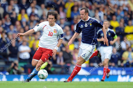 Stock Image of Football - Euro 2012 Qualifier - Scotland vs Czech Republic Charlie Adam (Scotland) chases Tomas Rosicky (Czech Republic) at Hampden Park