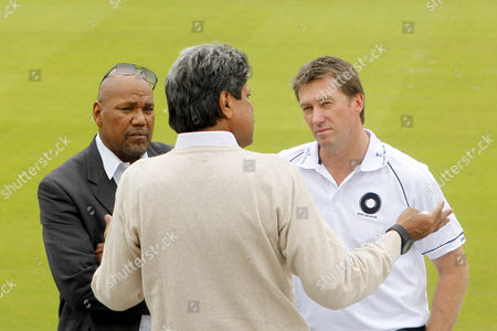 Cricket - The Lord's Taverners Fast Bowlers Dinner - Photo Call Kapil Dev chats to Colin Croft and Glenn McGrath at Lord's Cricket Ground