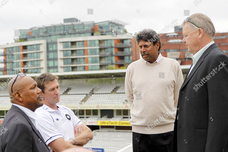 Cricket - The Lord's Taverners Fast Bowlers Dinner - Photo Call Colin Croft Glenn McGrath Kapil Dev and Mike Procter chat at Lord's Cricket Ground