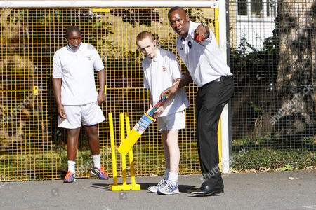 Stock Picture of Cricket - Lord's Taverners fast bowlers - School Kids training session England Cricketer Devon Malcolm joins in a cricket training session with the boys at Archbishop Tenison's School Kennington