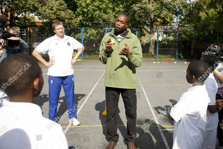 Stock Photo of Cricket - Lord's Taverners fast bowlers - School Kids training session Australian Cricket legend Glen McGrath and West Indian fast bowler Curtly Ambrose join in with a cricket training session with the boys at Archbishop Tenison's School Kennington