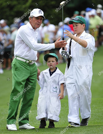 Golf - US Masters 2012 - Augusta Georgia Gary Player gets help from his grandsons Dallen Hall 12 right and Alex Hall 4 during the Par-3 Contest of the 2012 Masters U.S. Augusta