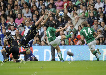 Rugby Union - International - Scotland vs Ireland Alastair Kellock (Scotland) attempts to stop the kick Isaac Boss (Ireland) at Murrayfield