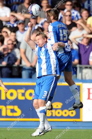 Football - League One - Hartlepool vs Sheffield Wednesday both Ritchie Humphreys (Hartlepool United) and Antony Sweeney (Hartlepool United) go for the same ball at Victoria Park UK