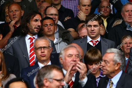 Football - Premier League - Liverpool vs Sunderland Steven Gerrard and Sotirios Kyrgiakos of Liverpool starts the season from the stands at Anfield