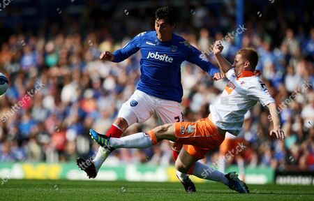 Football npower Championship Portsmouth vs Blackpool at Fratton Park Portsmouth's Joel Ward battles with Blackpool's Keith Southern 24/09/2011