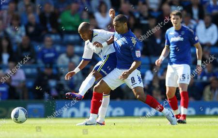Football npower Championship Portsmouth vs Cardiff City at Fratton Park Portsmouth's Hayden Mullins battles with Cardiff City's Robert Earnshaw 27/08/2011