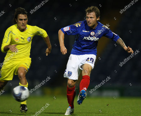 Football Charity Friendly Portsmouth vs FC Rostov at Fratton Park Portsmouth's Bjorn Helge Riise battles with FC Rostov's Oscar Ahumada 05/10/2011