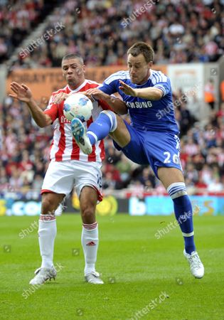 Football - Premier League - Stoke City Vs Chelsea Stoke's Jonathan Walters is challenged by Chelsea's John Terry at The Britannia Stadium