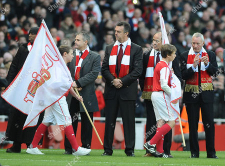 Football - Premier League - Arsenal vs Everton Emirates stadium Ex Arsenal players line up to greet the two teams during their 125th anniversary celebrations L to R Anders Limpar David O'Leary George Graham and Terry Neill