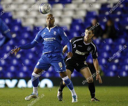 Football - Championship - Birmingham City vs Ipswich Town- Birmingham's Marlon King holds off Ipswich's Tommy Smith at St Andrews