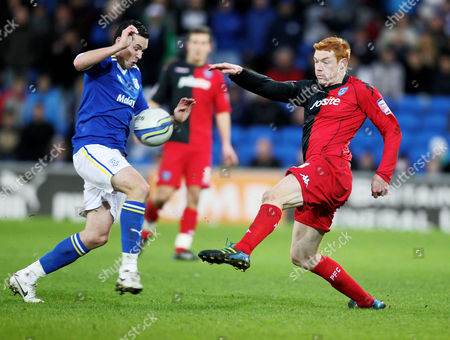 Football Npower Championship Cardiff City vs Portsmouth at Cardiff City Stadium Portsmouth's Dave Kitson battles with Cardiff's Don Cowie 21/01/2012