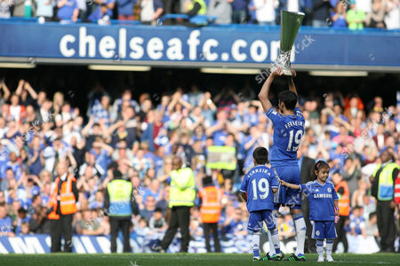 Football - 2012 / 2013 Premier League - Chelsea vs Everton Paulo Ferreira of Chelsea lifts the Europa League Trophy at Stamford Bridge at Stamford Bridge