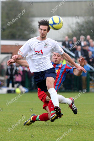 Football - FA Cup First Round - AFC Totton vs Bradford Park Avenue Tom Greaves of Bradford Park Avenue fouls AFC Totton's Tom Baddeley at Testwood Stadium