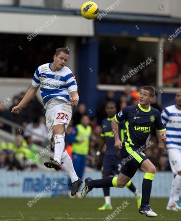 Football - Premier League - Queens Park Rangers vs Wigan Athletic Heidar Helguson of QPR gets up high to get the ball away from James McCarther of Wigan UK London,