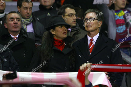Stock Picture of Football - Carling Cup Semi-Final Second Leg - Liverpool vs Manchester City Liverpool owner John Henry and wife Linda Pizzuti in front of director Ian Ayre and Damien Comolli at Anfield