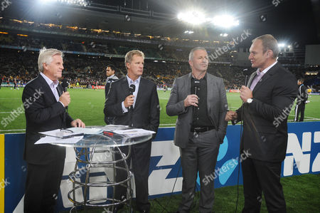 Stock Photo of New Zealand v Australia ; Auckland; RWC Semi Final Eden Park Stadium World Cup Rugby panel L to R Steve Ryder Itv sports commentator Michael Lynagh (Australia) Sean Fitzpatrick (New Zealand) and (South Africa)