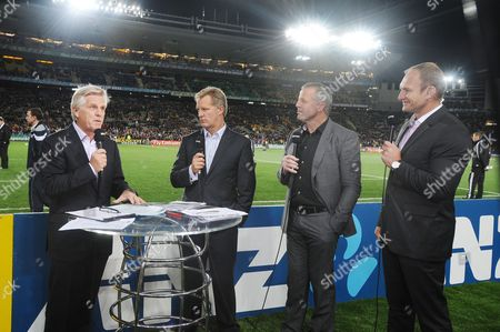 Stock Picture of New Zealand v Australia ; Auckland; RWC Semi Final Eden Park Stadium World Cup Rugby panel L to R Steve Ryder Itv sports commentator Michael Lynagh (Australia) Sean Fitzpatrick (New Zealand) and (South Africa)
