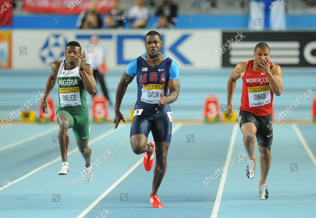Stock Photo of Athletics - World Indoor Championships 2012 - Istanbul (from Left to Right) Nigeria's Peter Emelieze Justin Gatlin of the US and Morocco's Aziz Ouhadi compete in heat 1 during the men's 60m semi-final at the 2012 IAAF World Indoor Athletics Championships at the Atakoy Athletics Arena Turkey Istanbul