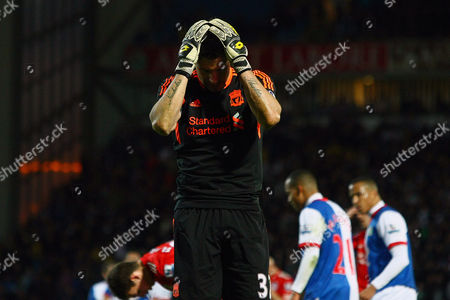 Football - Premier League - Blackburn Rovers vs Liverpool Alexander Doni of Liverpool looks dejected following his red card at Ewood Park