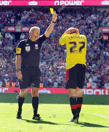 Football - 2013 Championship Play-Off Final - Crystal Palace vs Watford Referee Mr martin Atkinson gives Marco Cassetti the yellow card for fouling Wilfried Zaha which resulted in Kevin Phillips scoring from the penalty spot for the winning goal at Wembley Great Britain