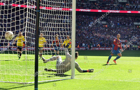 Stock Photo of Football - 2013 Championship Play-Off Final - Crystal Palace vs Watford Kevin Philips - C Palace scores the winning goal from the Penalty spot past the diving Manuel Almunia at Wembley Great Britain