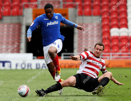 Football Npower Championship Doncaster vs Portsmouth at Keepmoat Stadium Doncaster's Chris Brown battles with Portsmouth's Kelvin Etuhu 14/04/2012