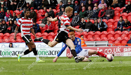 Football Npower Championship Doncaster vs Portsmouth at Keepmoat Stadium Portsmouth's Dave Kitson goes down for Portsmouth's first penalty goal scored by Greg Halford 14/04/2012