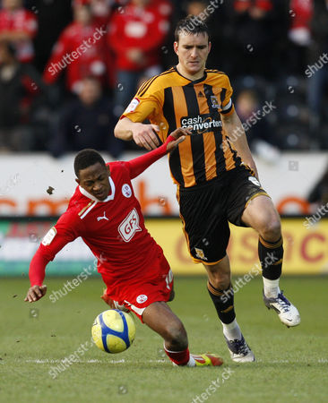 Football - FA Cup Fourth Round- Hull City vs Crawley Town- Hull's Jack Hobbs is booked for this challenge on Crawley's Sanchez Watt at The KC Stadium
