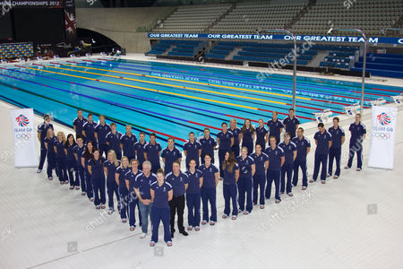 Swimming - Olympic Trials - London Aquatic Centre The 38 selected team GB swimmers with Chef de Mission Andy Hunt and Michael Scott at the London Aquatics centre
