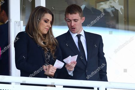 Horse Racing - Grand National Meeting Day One - Aintree Manchester United star Darren Fletcher checks his betting slips with wife Hayley Grice