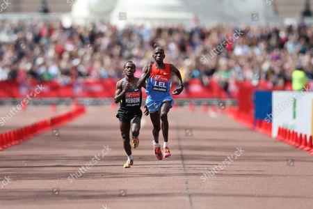 Athletics - The Virgin London Marathon 2012 Martin Lel of Kenya and Tsegaye Kebede of Ethiopia race for the finish line