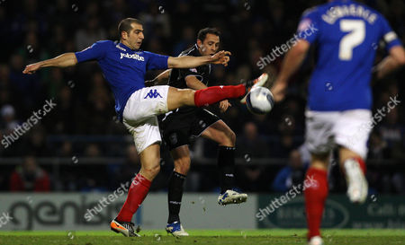 Stock Image of Football Npower Championship Portsmouth vs Ipswich Town at Fratton Park Portsmouth's Tal Ben Haim battles with Ipswich's Michael Chopra 14/02/2012
