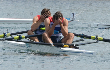 Rowing - 2012 London Olympics - Men's Lightweight Double Sculls Final Great Britain's Mark Hunter and Zac Purchase hold their heads in their hands after just being beaten to the gold by Denmark at Eton Dorney