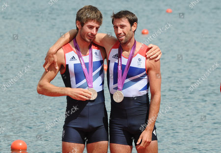 Rowing - 2012 London Olympics - Men's Lightweight Double Sculls Medal Ceremony Great Britain's silver medalists Mark Hunter and Zac Purchase at Eton Dorney