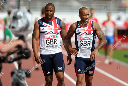 Athletics - European Championships - Helsinki Mark Lewis Francis and James Ellington of Great Britain walk down the track after the 4 x 100m relay heats during day Four of the European Athletics Champions in The Olympic Stadium Helsinki on 30th June 2012  Germany Helsinki