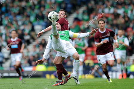 Football - Scottish FA Cup Final - Hibernian vs Hearts James McPake (Hibernian) clears as Stephen Elliott (Hearts) closes in at Hampden Park