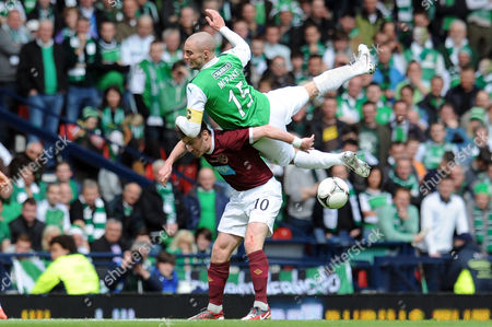 Football - Scottish FA Cup Final - Hibernian vs Hearts James McPake (Hibernian) and Stephen Elliott (Hearts) battle for the ball at Hampden Park