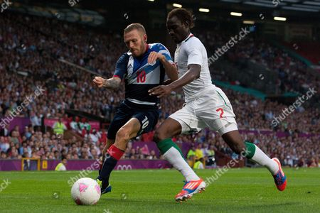 Football - London 2012 Olympics - Great Britain vs Senegal Craig Bellamy of Team GB and Saliou Ciss of Senegal battle at Old Trafford Manchester