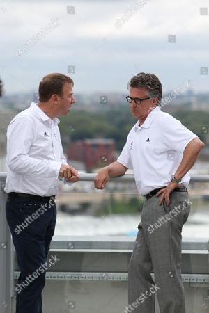Team GB Chef de Mission Andy Hunt (left) and Head Coach Charles van Commenee (right) talk during the photo call The BOA has announced today 71 track and field athletes selected to Team GB for the London 2012 Olympic Games