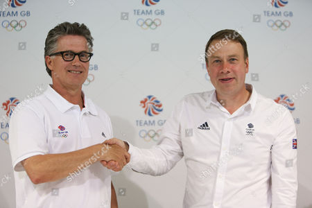 Team GB Head Coach Charles van Commenee (left) and Chef de Mission Andy Hunt shake hands at the press conference at Team GB House Stratford The BOA has announced today 71 track and field athletes selected to Team GB for the London 2012 Olympic Games