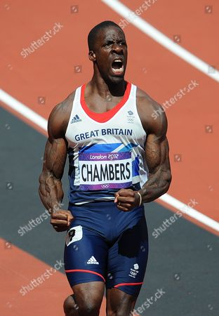 Olympics - London 2012 - Athletics Dwayne Chambers (GB) celebrates winning his 100m heat in 10 02s at the Olympic Stadium London