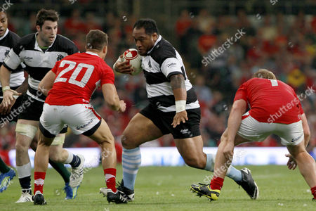 Rugby Union - International Friendly - Wales vs The Barbarians Barbarian's Neemia Tialata runs at Rhys Webb of Wales at The Millennium Stadium Wales