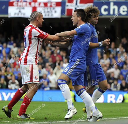 Football - Premier League Chelsea vs Stoke City Jonathan Walters John Terry and David Luiz