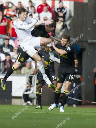 Football - 2012 / 2013 Premier League - Swansea vs Wigan Michu (Miguel Perez Cuesta) and James McArthur leap to head the ball at Liberty Stadium UK swansea